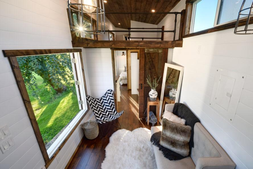 aerial view of tiny home interior with sofa and small chair