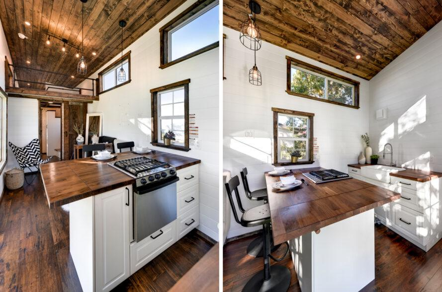tiny home kitchen with white cabinets and bar seating