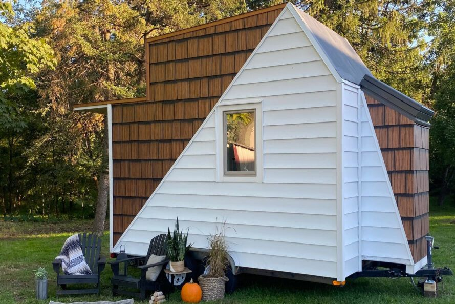 white and timber tiny home on wheels