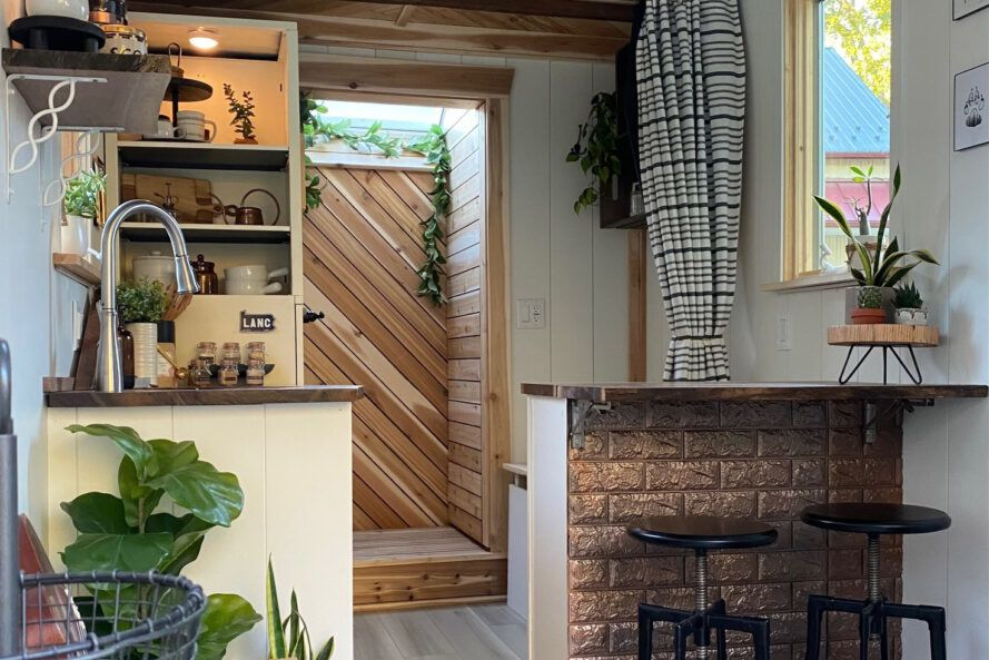 cedar-lined shower stall behind a tiny home kitchen