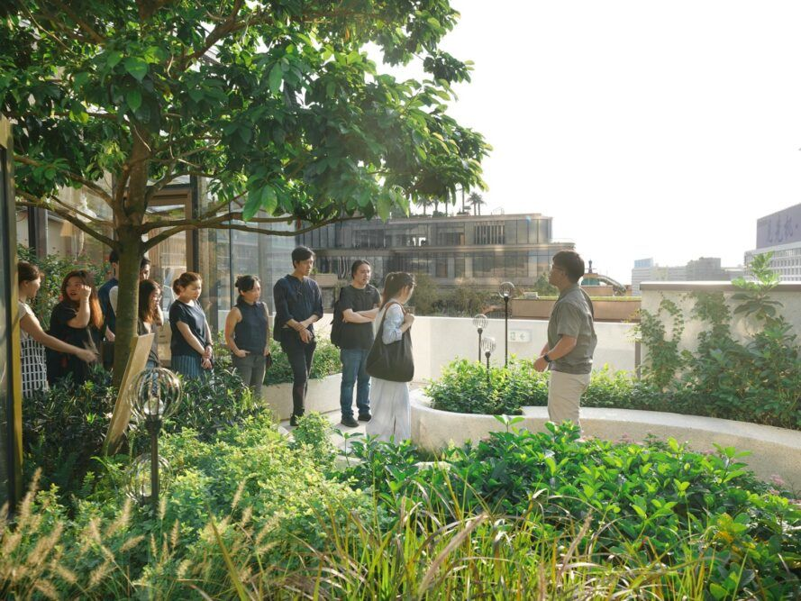 tour guide discussing plants to visitors