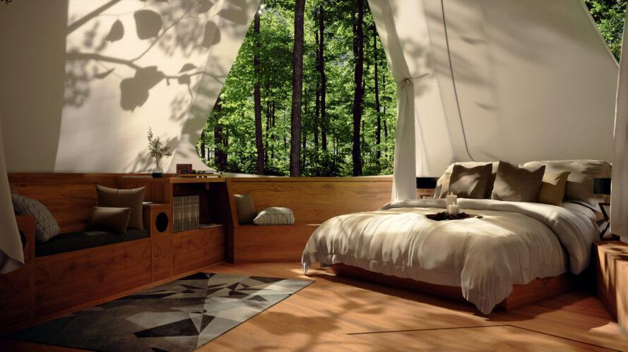 treehouse interior with large bed and built-in wood bench