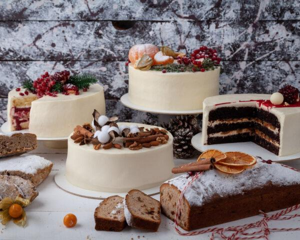 holiday cakes and breads on white table