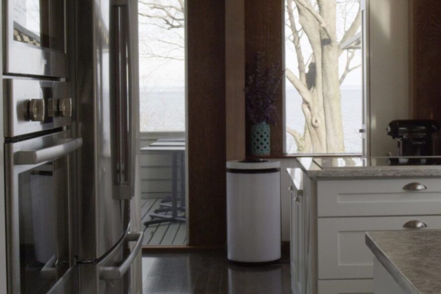 black and white round air purifier in a kitchen