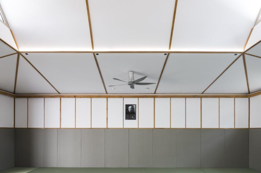 fan on white ceiling with wood beams