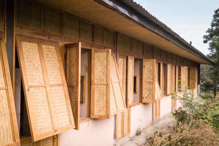 Windows and shutters on the exterior of the building made with natural materials.