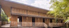 A two-story building with natural materials of bamboo and rice husk.