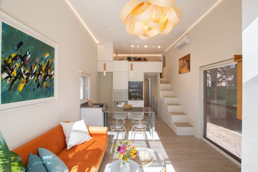 living area with orange sofa and flower-shaped ceiling light