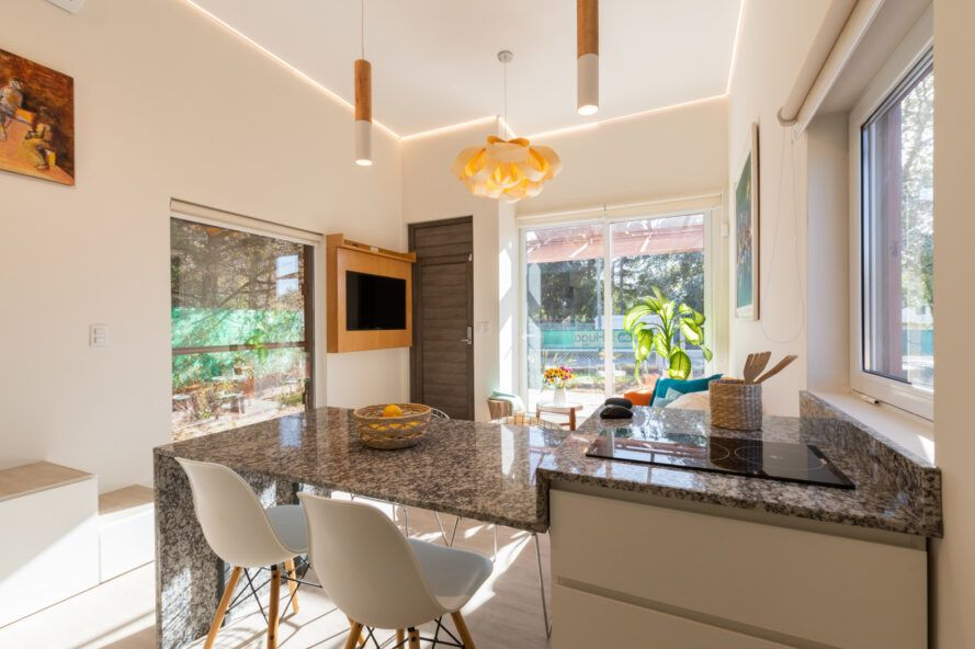 kitchen with granite counters and two small bar stools