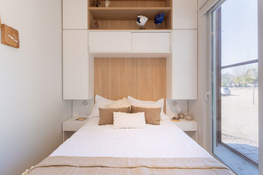 small white bedroom with light wood accents