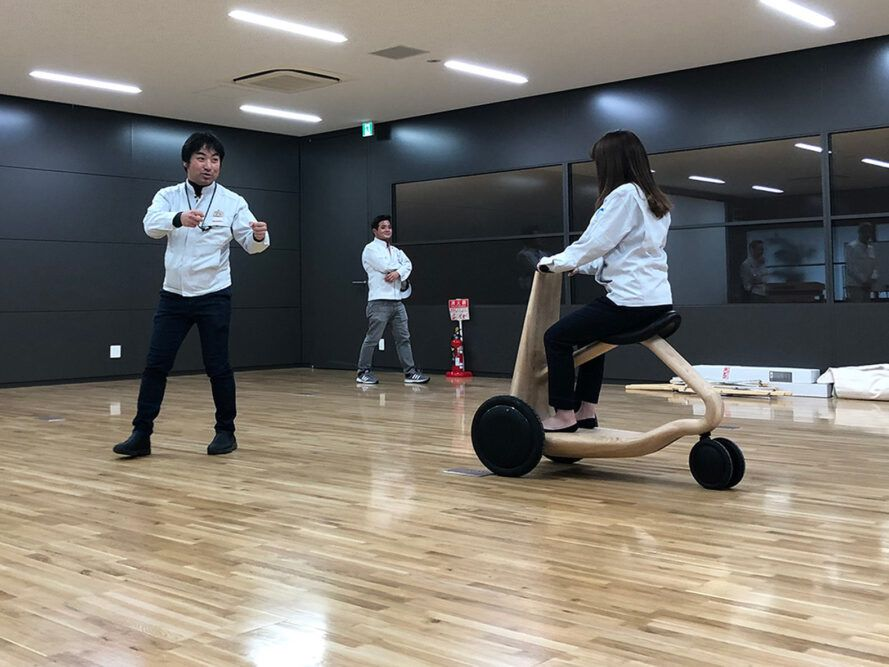person testing a wood scooter