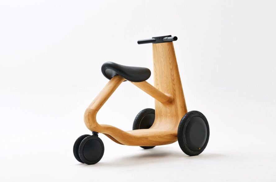 back of wood scooter with three wheels