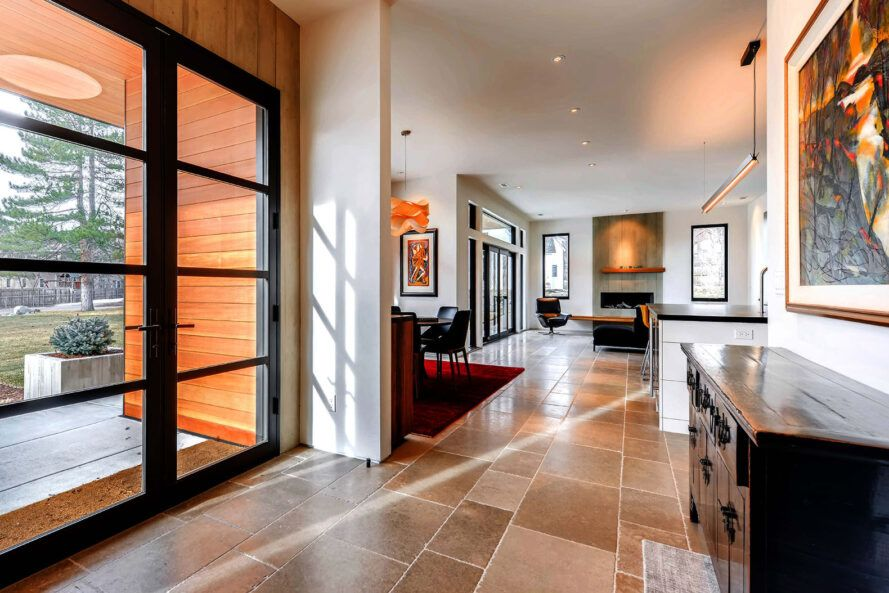 A hallway leading from the entry room into the living room.