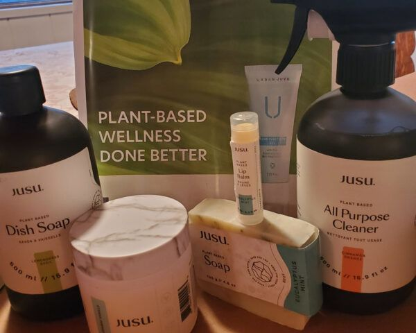 natural skincare and cleaning products in a box