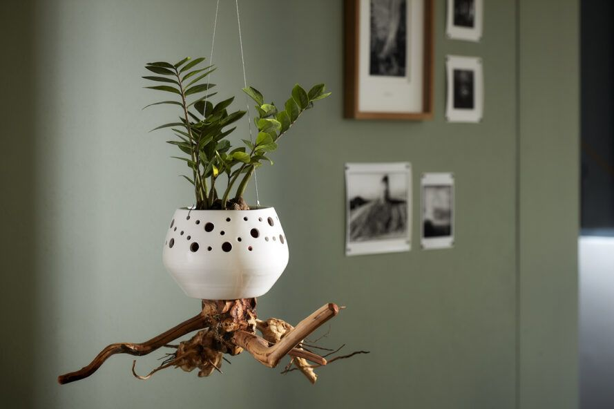 A hanging planter following the same design as the first, save for a smaller, squat shape.