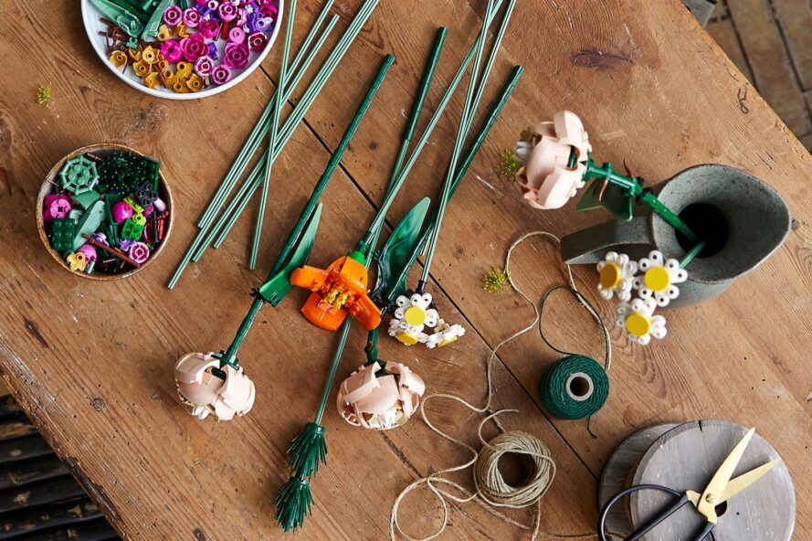 LEGO-based flower petals and stems on wood table