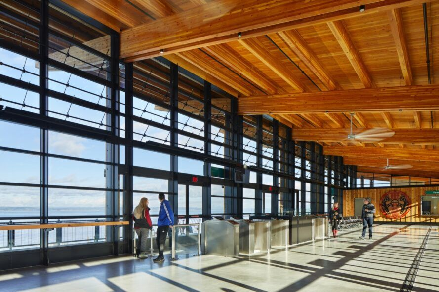 transit hub interior with wood ceilings and glass walls