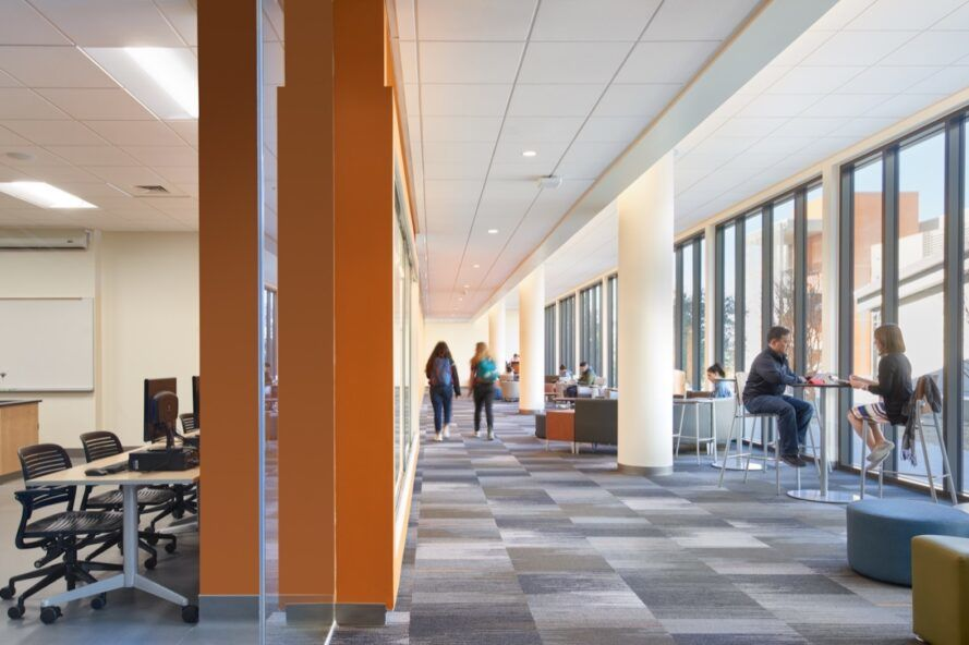 bright college building interior with gray floors and wall of windows