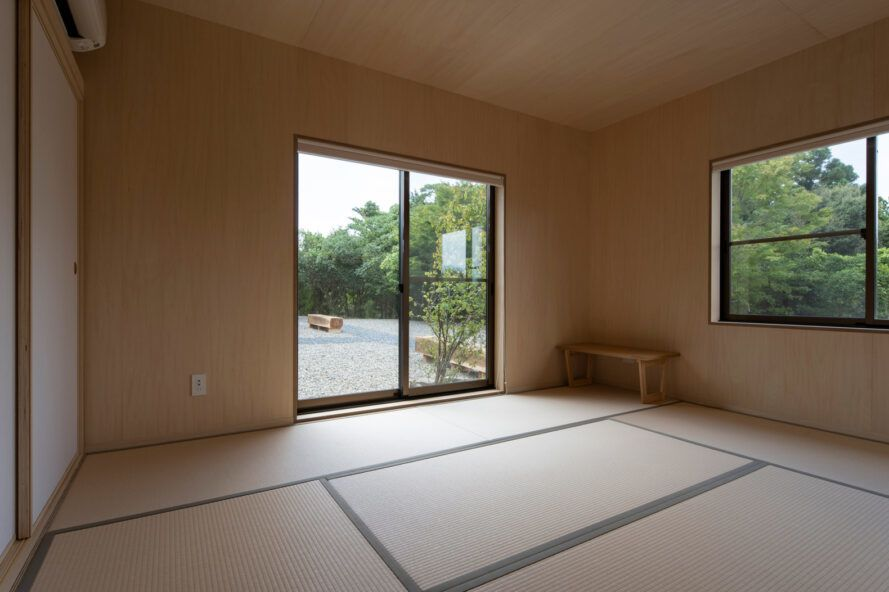 guestroom with wood walls and sliding glass doors leading to a balcony