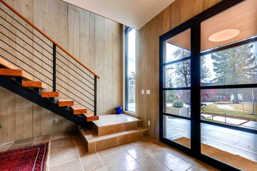 A stairwell next to two large windows.