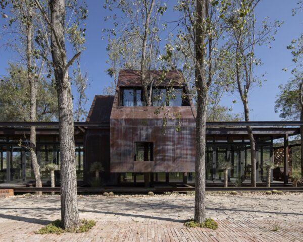 holiday home with oxidized steel and glass exterior
