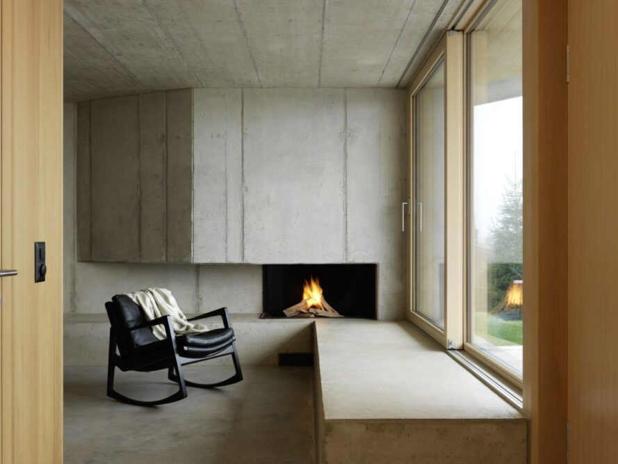 rocking chair by concrete fireplace