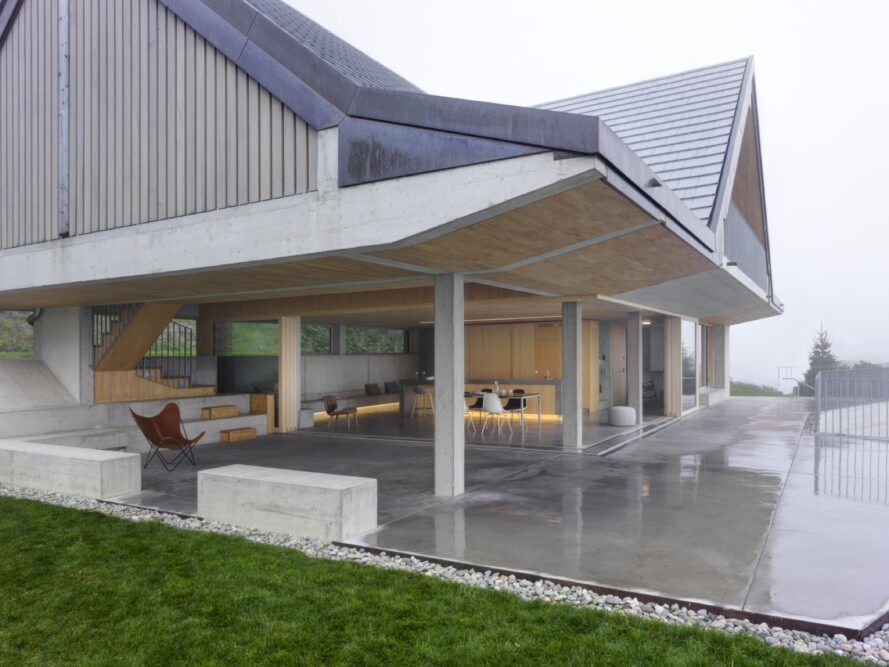 concrete and wood home with large covered patio