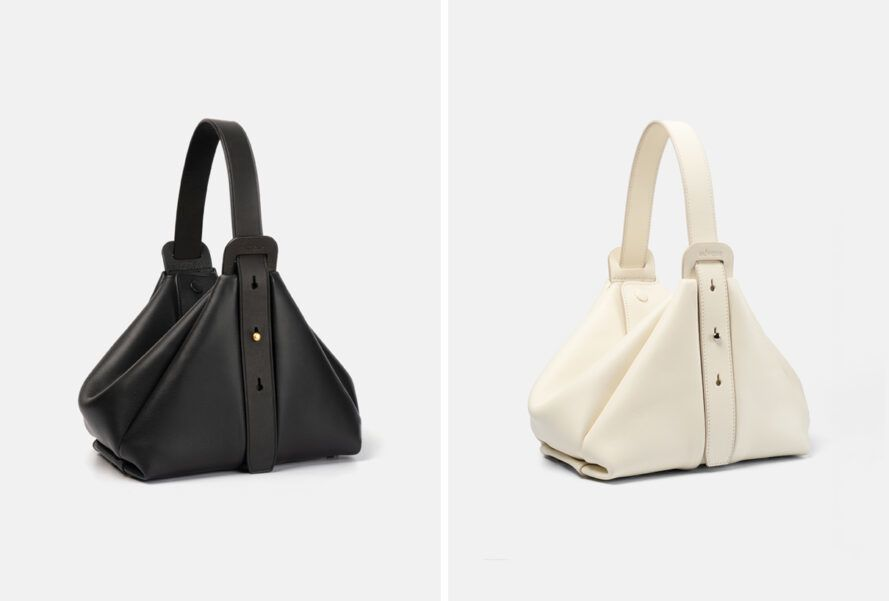 angled view of a handbag in two colors, black or white