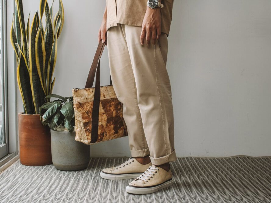 person wearing beige outfit and mushroom leather shoes