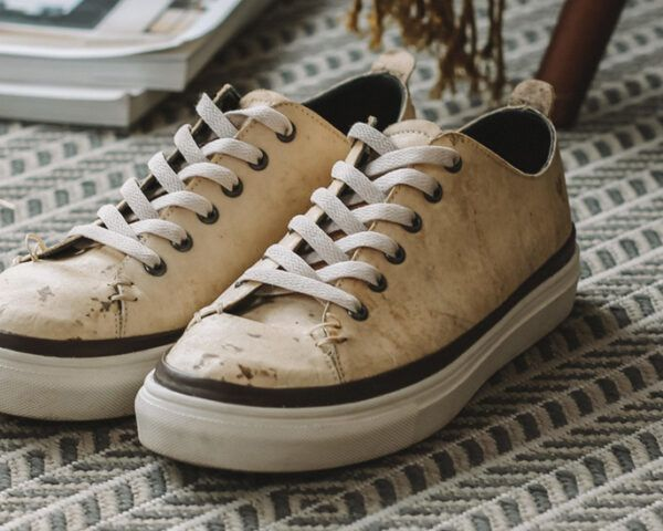 mushroom leather sneakers on patterned carpet