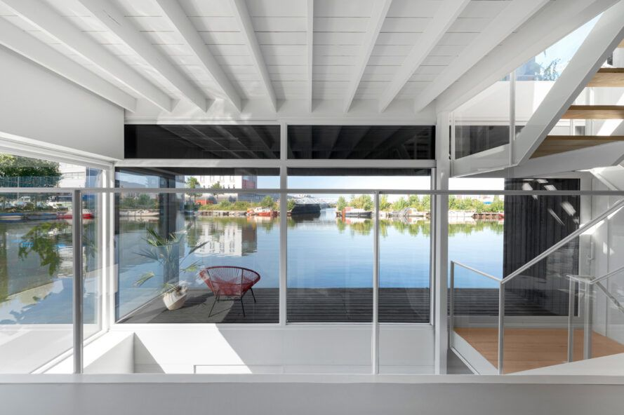 glass walls that open to wood patio