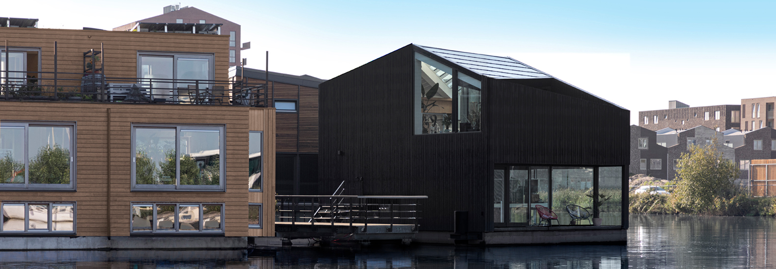 This home floats in a self-sufficient Amsterdam neighborhood
