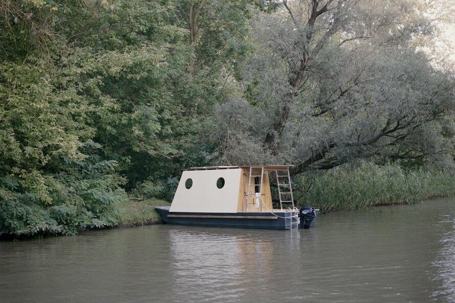 wood houseboat with angled body