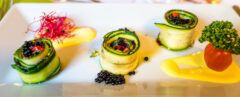 vegan zucchini rolls artfully arranged on a plate