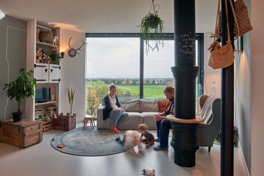family sitting and playing together in a small living room