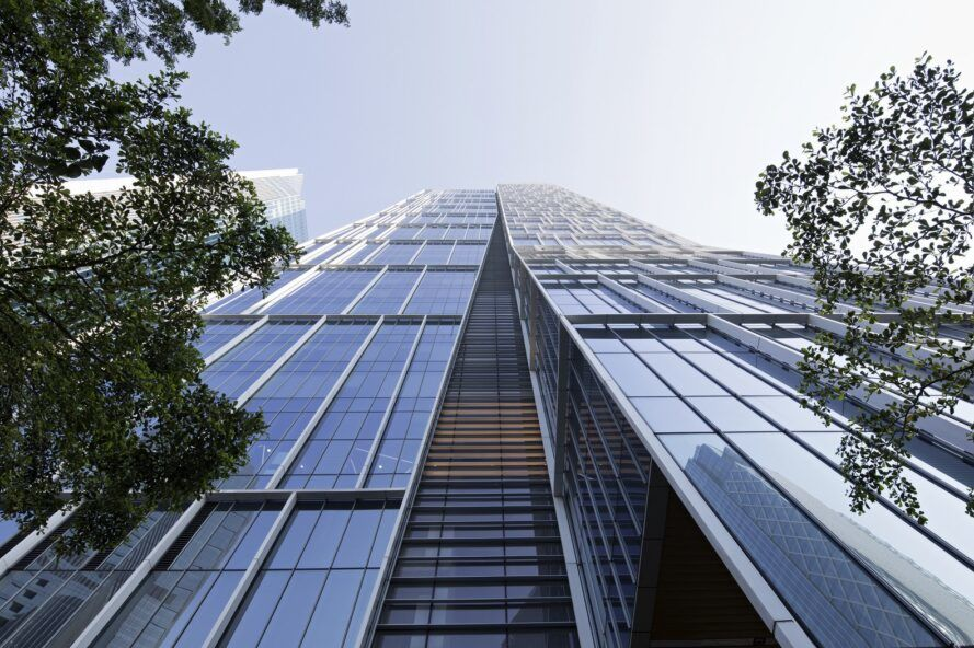 An image looking up at the side of a high-rise tower.