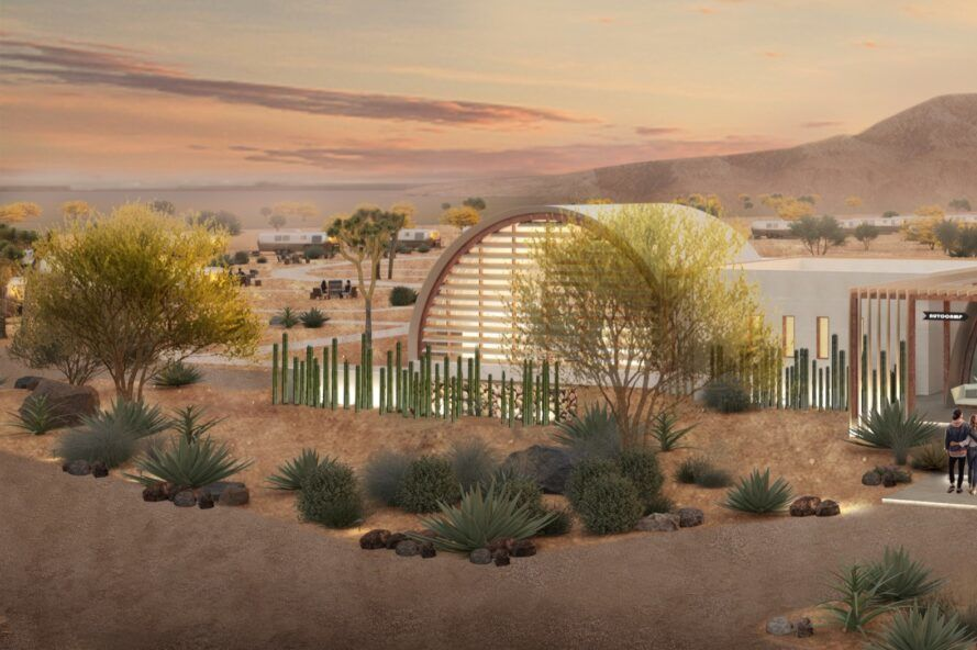 rendering of desert plants surrounding arched building