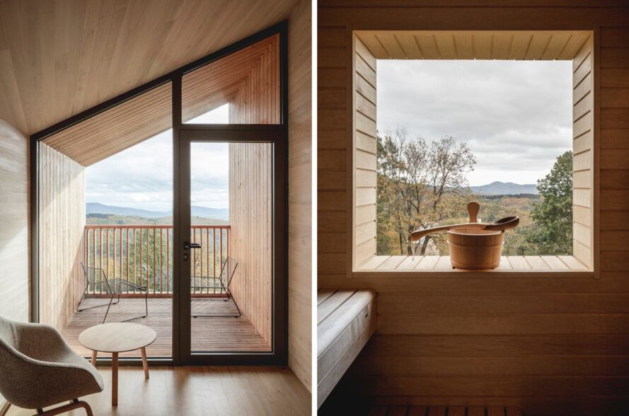 wood cabin interior with large windows framing mountain views outside