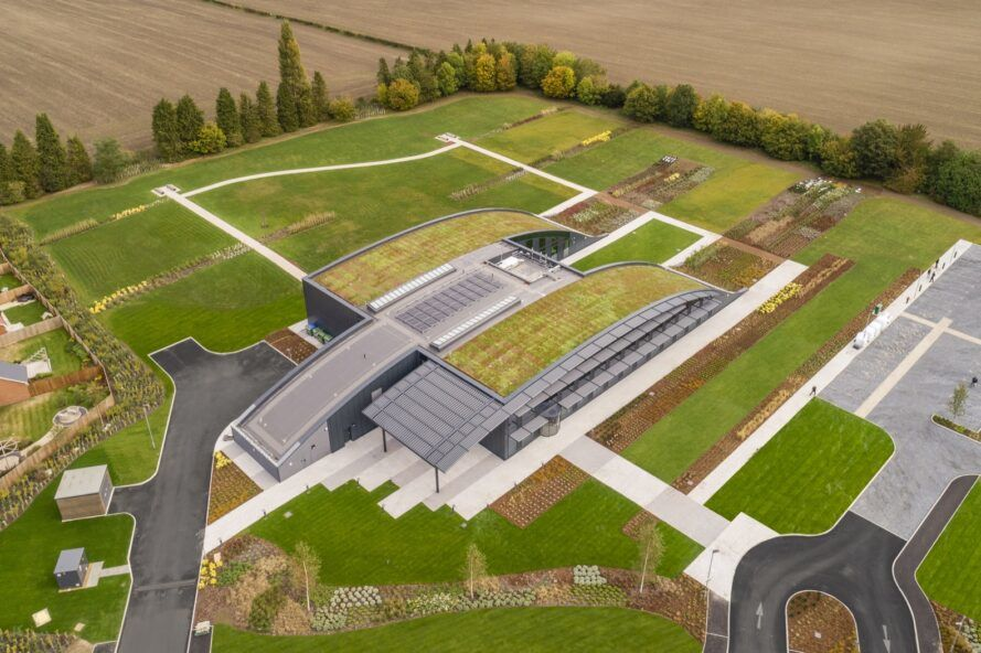 A bird's-eye view of an office complex with a green roof.