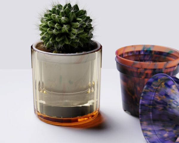 A cactus in a recycled plastic pot, sitting next to two other plastic pots in various shades of red and purple.