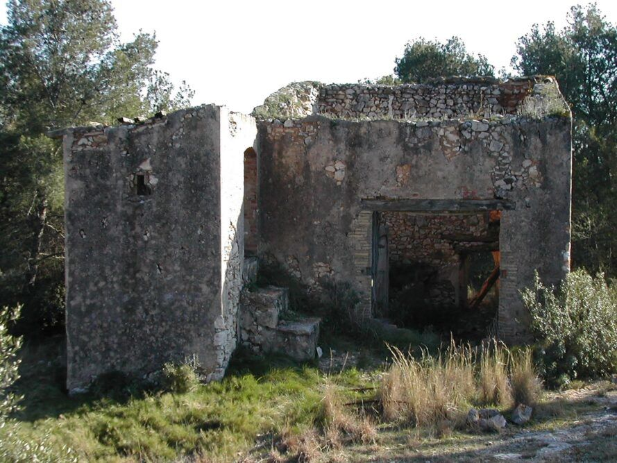 before photo of stone ruins