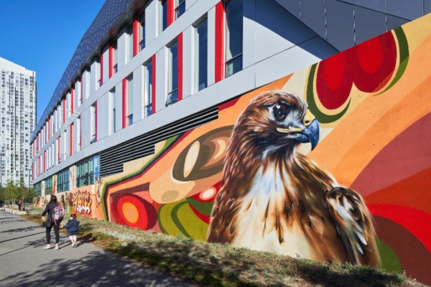 A mural of a bird on the side of a building.