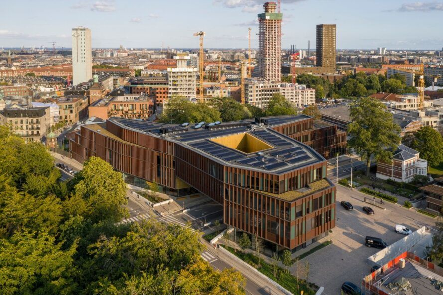 solar panels atop glass and copper building