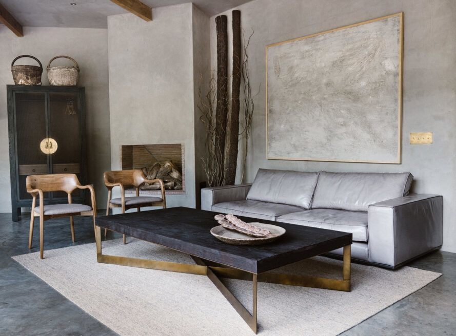 gray sofa near gold and black coffee table