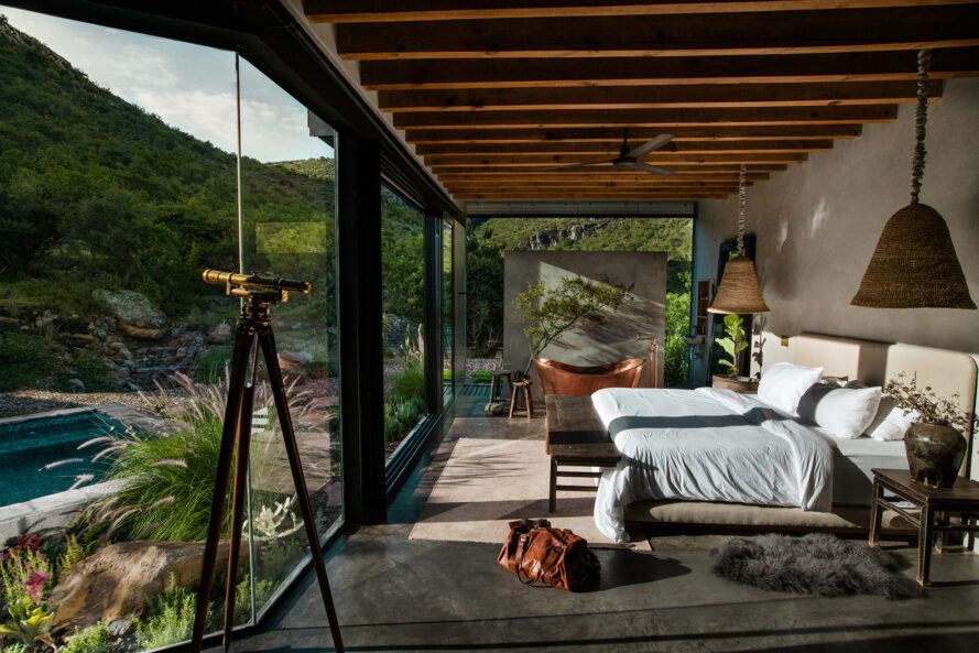 large bed facing wall of glass
