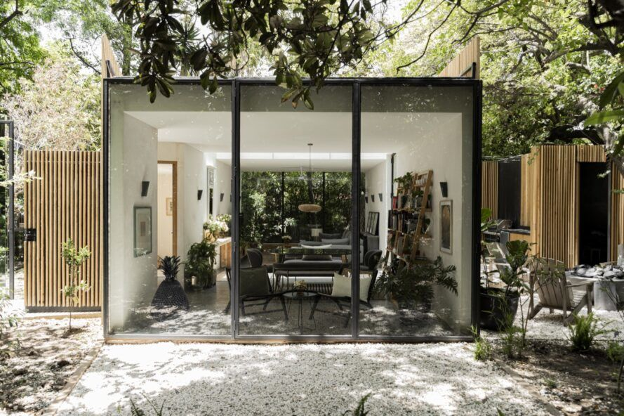 open-plan living and dining area behind a glass wall