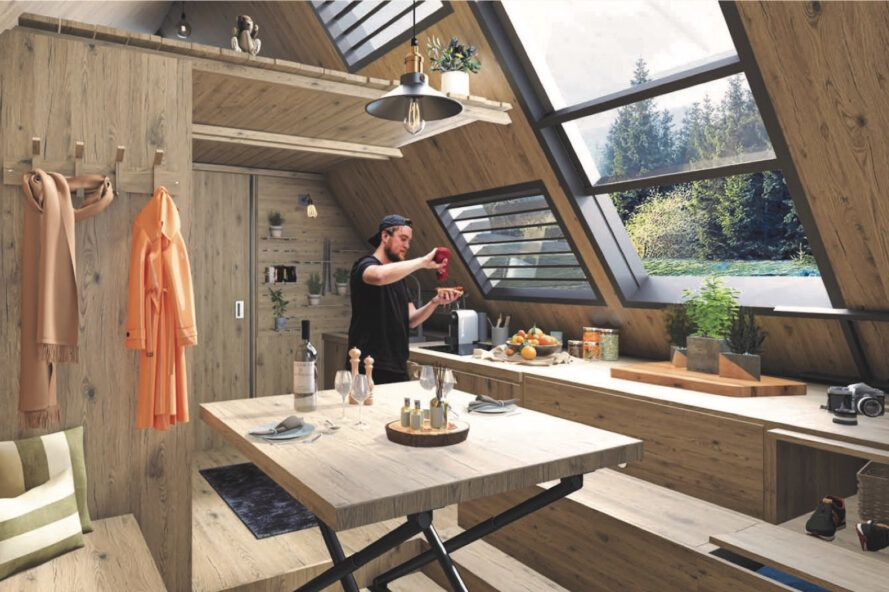 rendering of wood cabin interior with wood dining table and a large window