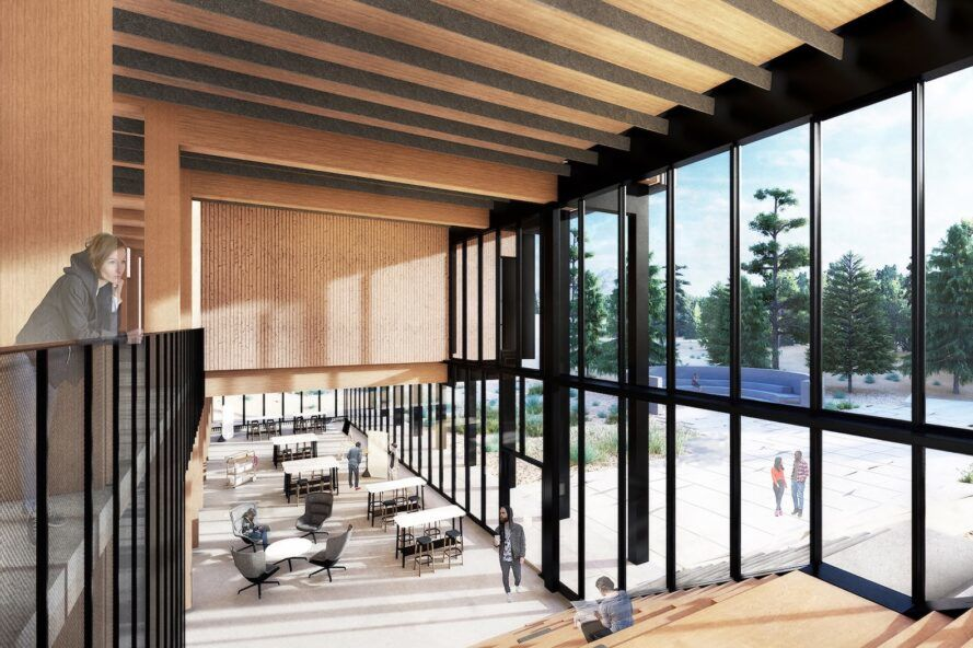 rendering of double-height interior with wood walls and ceiling and one full wall of glass