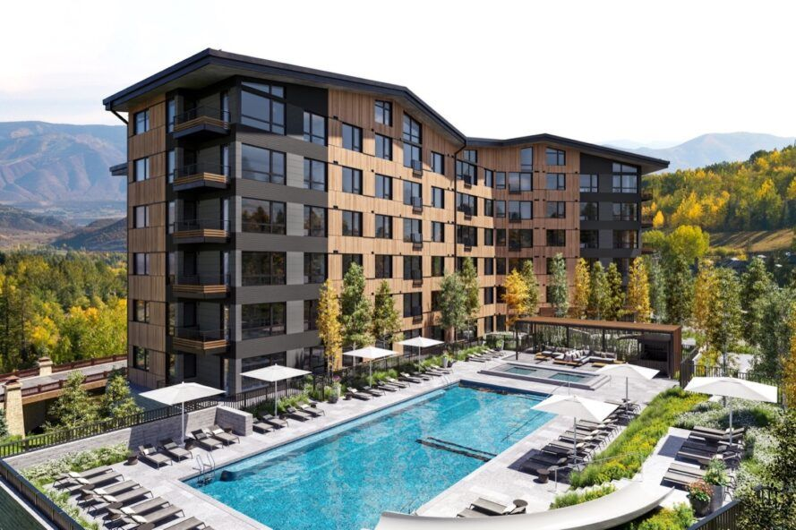 brown and gray condo building with pool