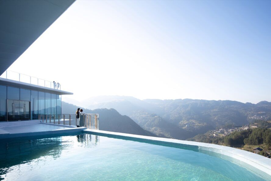 Infinity pool overlooking mountains and valleys
